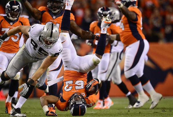 DENVER, CO - SEPTEMBER 23: Denver Broncos outside linebacker Wesley Woodyard (52) falls over after recovering a fumbled that was called back in the second quarter. The Denver Broncos took on the Oakland Raiders at Sports Authority Field at Mile High in Denver on September 23, 2013. (Photo by AAron Ontiveroz/The Denver Post)